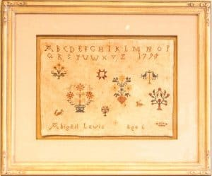 Old needlework sampler done by 6-year-old