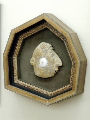 Stone Profile, mounted in an irregular polygon frame.  The frame highlights the contours of the face.
